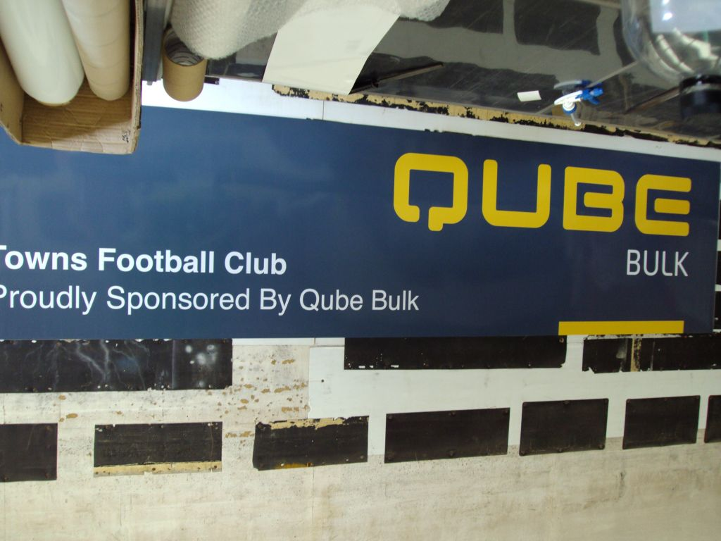 Qube Towns Football Sponsor Sign